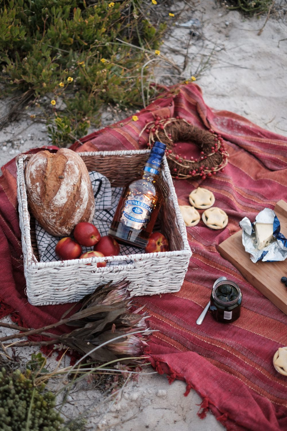 Scene of a beach picnic, shot by influencer Scrumpy Jack